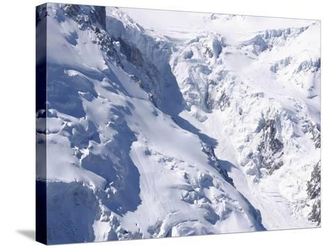 Aerial View of Cold Snow with Jagged Formations on a Rocky Mountain--Stretched Canvas Print