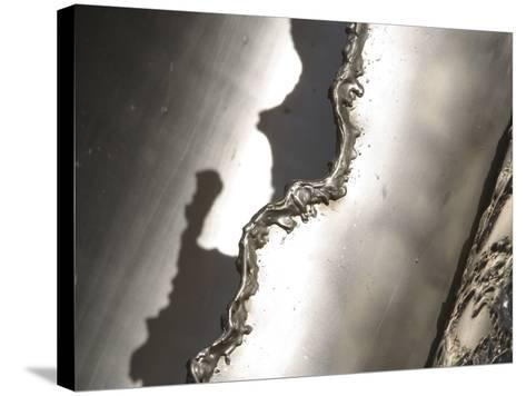 Close-up of Rough Texture Engraved on a Shiny Metallic Surface--Stretched Canvas Print
