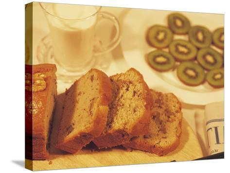 Sliced Coffee Cake and Kiwi Fruit--Stretched Canvas Print