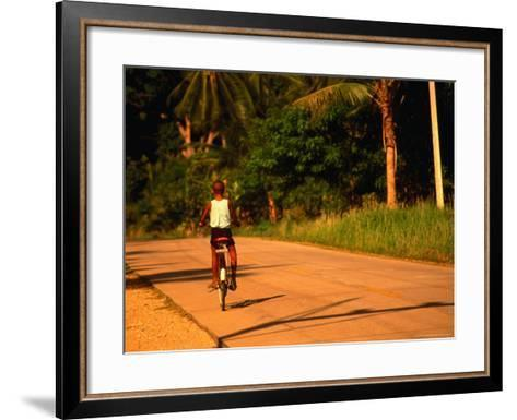 Boy Riding Bike on Dirt Road, Ko Samui, Surat Thani, Thailand-Dallas Stribley-Framed Art Print