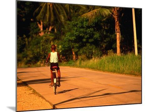 Boy Riding Bike on Dirt Road, Ko Samui, Surat Thani, Thailand-Dallas Stribley-Mounted Photographic Print
