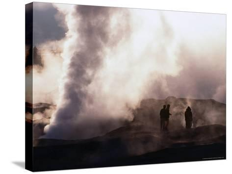 People Silhouetted Against Steam from Geyser Vent, Sol De Manana, Bolivia-Brent Winebrenner-Stretched Canvas Print