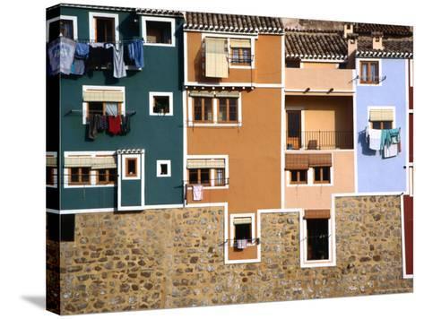 Washing Hanging from House Windows in La Vila Joiosa, Benidorm, Spain-Mark Daffey-Stretched Canvas Print