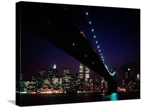 Brooklyn Bridge and Skyline of New York City at Night--Stretched Canvas Print