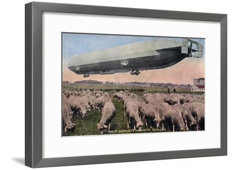 Germany - View of a Zeppelin Blimp over Grazing Sheep-Lantern Press-Framed Art Print