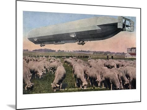 Germany - View of a Zeppelin Blimp over Grazing Sheep-Lantern Press-Mounted Art Print