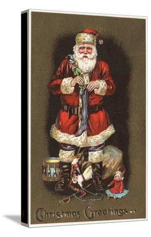Christmas Greetings - Santa Stuffing Stocking with Nutcracker-Lantern Press-Stretched Canvas Print