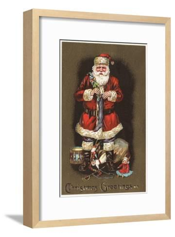 Christmas Greetings - Santa Stuffing Stocking with Nutcracker-Lantern Press-Framed Art Print