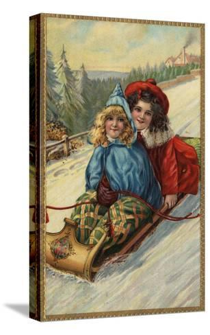 Christmas - Two Little Girls Sledding-Lantern Press-Stretched Canvas Print
