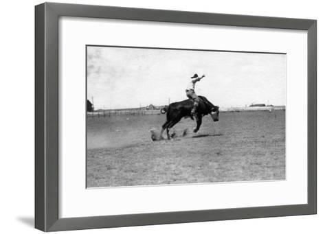 Cowboy Riding a Bucking Bull-Lantern Press-Framed Art Print