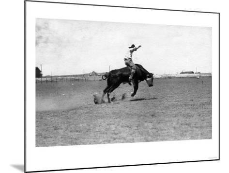 Cowboy Riding a Bucking Bull-Lantern Press-Mounted Art Print