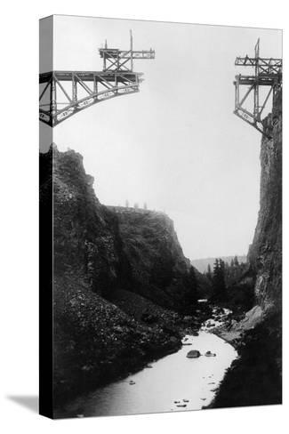 River View of O.T. Bridge Under Construction - Crooked River, OR-Lantern Press-Stretched Canvas Print
