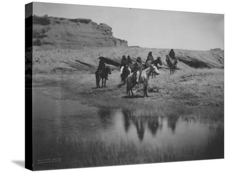 Six Navajo Indians on horseback, at Oasis Curtis Photograph-Lantern Press-Stretched Canvas Print