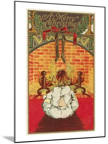 A Merry Christmas - Child in Front of Fireplace-Lantern Press-Mounted Art Print