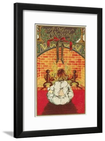 A Merry Christmas - Child in Front of Fireplace-Lantern Press-Framed Art Print