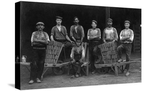 A Team of Bricklayers and Brick Carts-Lantern Press-Stretched Canvas Print