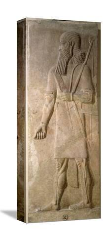 Relief of an Assyrian Warrior, from the Palace of Sargon II at Khorsabad, Iraq- Assyrian-Stretched Canvas Print