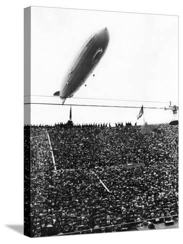 Graf Zeppelin Passing Low over Wembley Stadium During FA Cup Final Where Arsenal Beat Huddersfield--Stretched Canvas Print