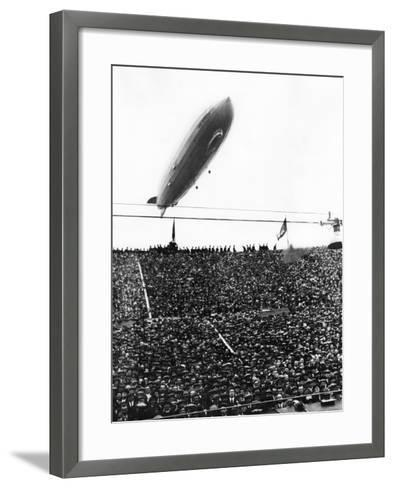 Graf Zeppelin Passing Low over Wembley Stadium During FA Cup Final Where Arsenal Beat Huddersfield--Framed Art Print