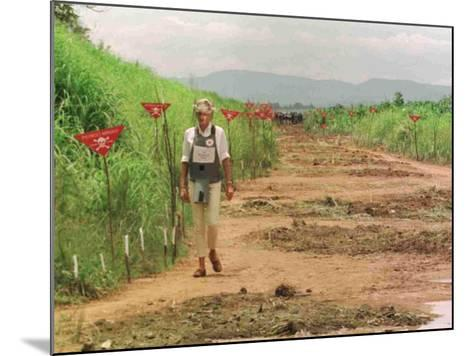 Princess Diana in Minefield Outside Haunbo Angola Endorsing the Red Cross Campaign--Mounted Photographic Print
