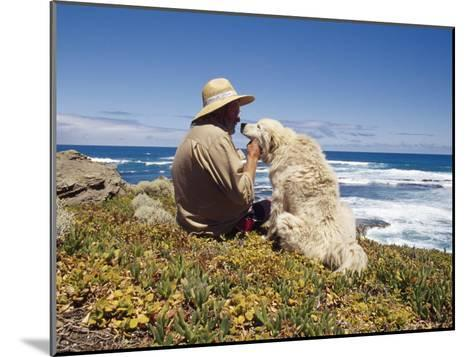 Man and His Italian Sheep Dog Sit Overlooking the Ocean-Jason Edwards-Mounted Photographic Print