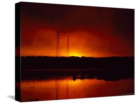 Silhouetted Power Lines at Sunrise Near a Calm Waterway-Heather Perry-Stretched Canvas Print