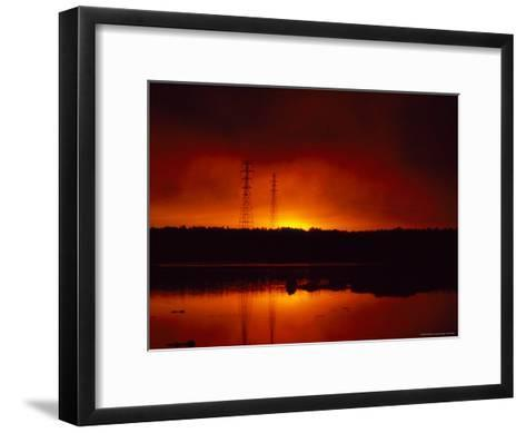 Silhouetted Power Lines at Sunrise Near a Calm Waterway-Heather Perry-Framed Art Print