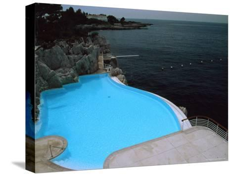 Pool on Mediterranean, Hotel Du Cap-David Evans-Stretched Canvas Print