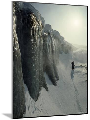 Skier on a Frozen Fjord Beneath Ice Cliffs of Nordenskjold Glacier-Gordon Wiltsie-Mounted Photographic Print