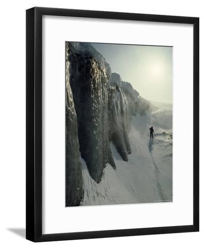 Skier on a Frozen Fjord Beneath Ice Cliffs of Nordenskjold Glacier-Gordon Wiltsie-Framed Art Print