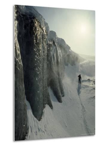 Skier on a Frozen Fjord Beneath Ice Cliffs of Nordenskjold Glacier-Gordon Wiltsie-Metal Print