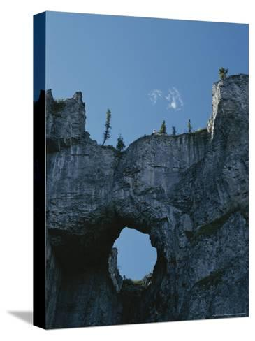 Erosion Carves a Window Into Limestone Rock in Nahanni National Park-Raymond Gehman-Stretched Canvas Print