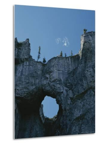 Erosion Carves a Window Into Limestone Rock in Nahanni National Park-Raymond Gehman-Metal Print