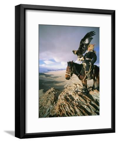 Hunter on Horseback Atop a Hill Holding a Golden Eagle in Mongolia-David Edwards-Framed Art Print