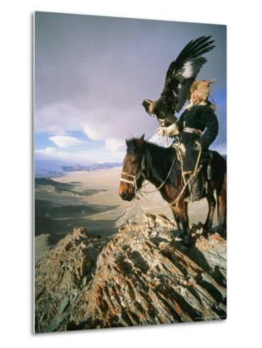 Hunter on Horseback Atop a Hill Holding a Golden Eagle in Mongolia-David Edwards-Metal Print