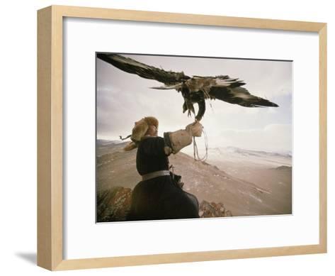 Kazakh Hunter Strains to Support a Golden Eagle-David Edwards-Framed Art Print
