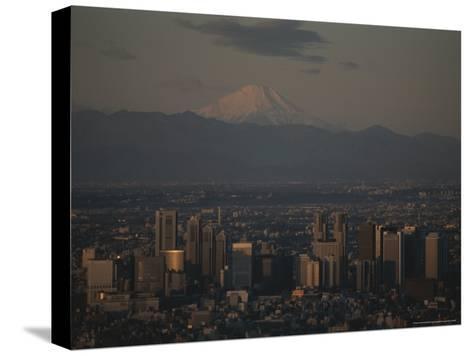 Mt. Fuji Looms in the Distance Over Tokyo's Skycrapers-Karen Kasmauski-Stretched Canvas Print
