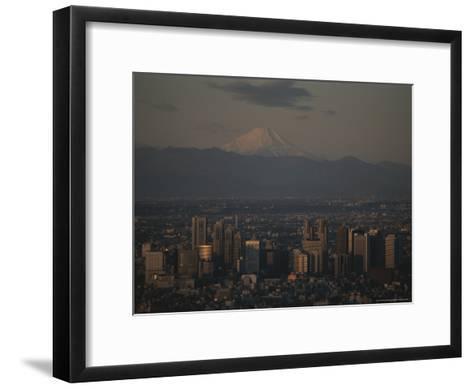 Mt. Fuji Looms in the Distance Over Tokyo's Skycrapers-Karen Kasmauski-Framed Art Print