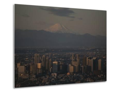 Mt. Fuji Looms in the Distance Over Tokyo's Skycrapers-Karen Kasmauski-Metal Print