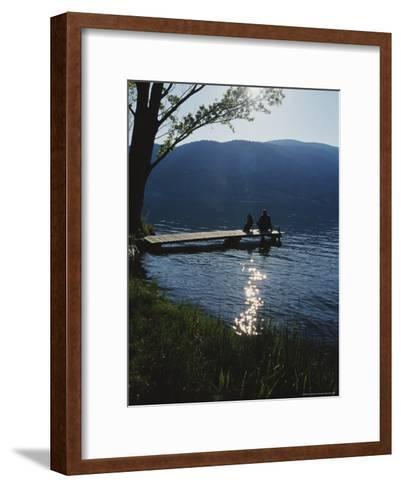 Man and His Dog on a Lake Skaha Dock-Mark Cosslett-Framed Art Print