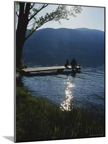 Man and His Dog on a Lake Skaha Dock-Mark Cosslett-Mounted Photographic Print