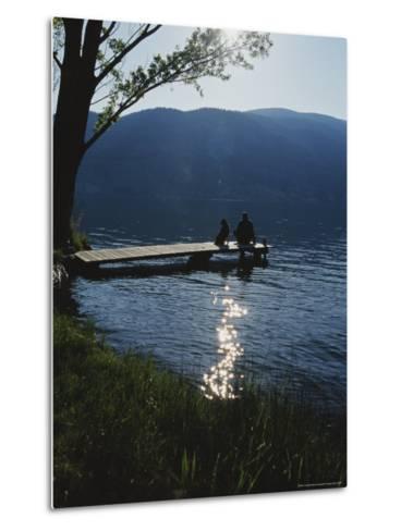 Man and His Dog on a Lake Skaha Dock-Mark Cosslett-Metal Print