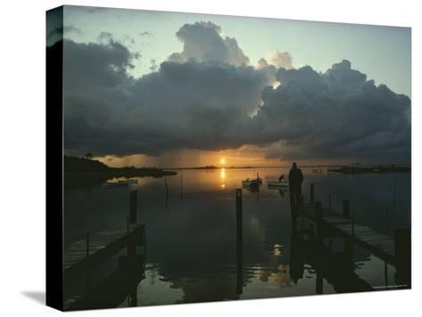 Small Fishing Boats Return to Dock as Clouds Gather at Sunset-Skip Brown-Stretched Canvas Print