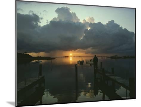 Small Fishing Boats Return to Dock as Clouds Gather at Sunset-Skip Brown-Mounted Photographic Print