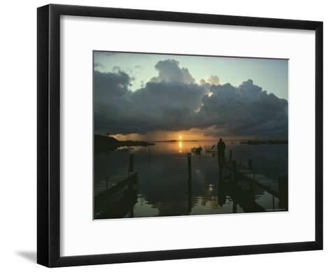 Small Fishing Boats Return to Dock as Clouds Gather at Sunset-Skip Brown-Framed Art Print