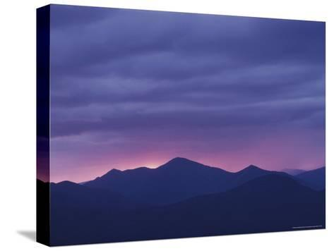 The Setting Sun Drops Behind the Adirondack's Mount Marcy-Michael Melford-Stretched Canvas Print