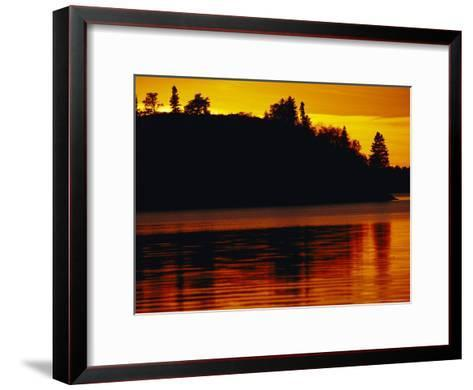 The Setting Sun Casts an Orange Glow Over Manitoba's White Lake-Raymond Gehman-Framed Art Print