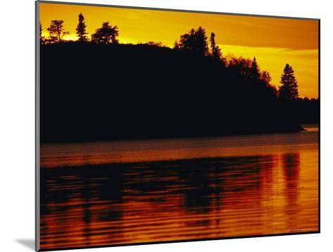 The Setting Sun Casts an Orange Glow Over Manitoba's White Lake-Raymond Gehman-Mounted Photographic Print
