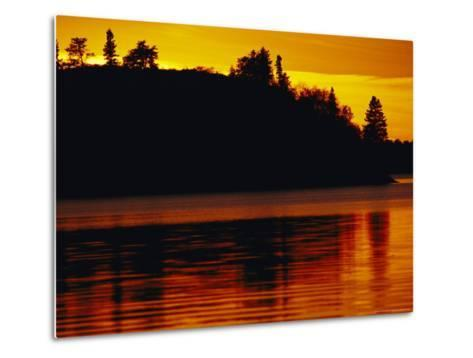 The Setting Sun Casts an Orange Glow Over Manitoba's White Lake-Raymond Gehman-Metal Print