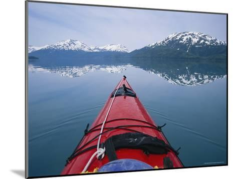 Kayak Plies Calm Waters Where Mountains Seem to Meet the Water-Bill Hatcher-Mounted Photographic Print